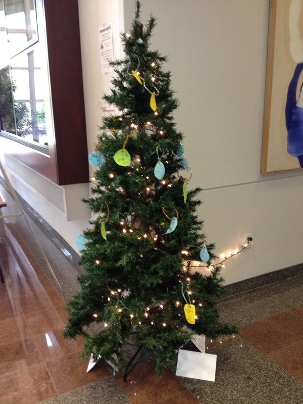 A festive tree located in the Plangere building for communication. By Amanda Gruber.