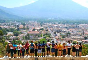 Participants in the alternative spring break trip look out onto the Guatemalan horizon. By Sandie Figueroa.