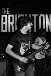 Band members jam out at the Brighton Bar.