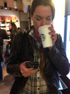A busy patron sips some delightful Starbucks concoction. By Caitlyn Bahrenburg.