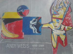 One of the many elaborate street art murals at the East Side Gallery in Germany.