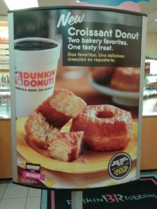 2. A promotional poster for Croissant Donuts at a local Dunkin Donuts.