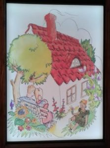 One of the more colorful artworks featured in the exhibit, depicting a family and their home.