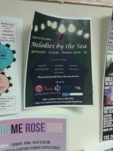 A flyer for Melodies by the Sea hangs among others in the Student Center.
