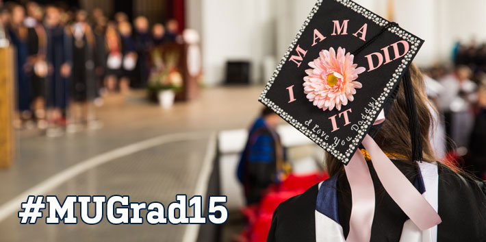 A Monmouth student's decorated cap helps to ring in graduation.