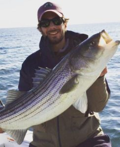 Pictured here is junior Chris Stark with a 40 inch striped bass. Photo courtesy of Ryan Gallagher